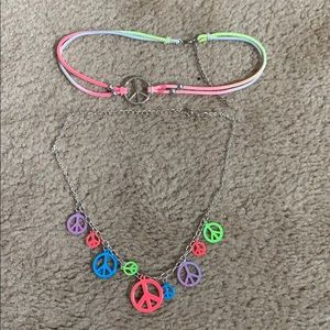 Set of two peace necklaces from Justice
